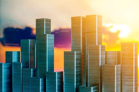 Staples arranged to form city skyline on a sunset background Standard-Bild - 116089597