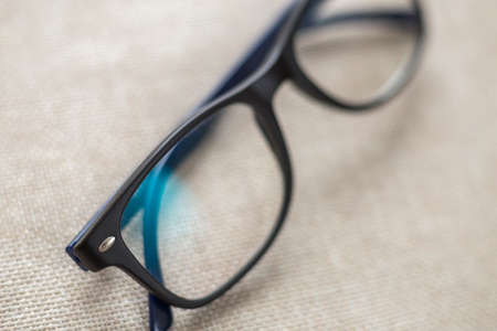 Reading spectacles, fashionable eyeglasses isolated on blurred white copy space background.