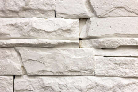 Close-up of white solid limestone wall or stone fence. Abstract copy space background, Bricklaying, construction and masonry concept. Stock Photo