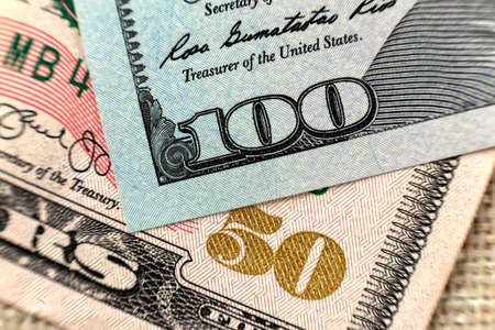 Money colorful background close-up. Details of American national currency banknotes bills. Symbol of wealth and prosperity. Cash, busyness and finances concept. Banco de Imagens