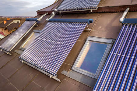 Solar water heating system on house roof. Hot water boiler, alternative ecological sun energy generator.