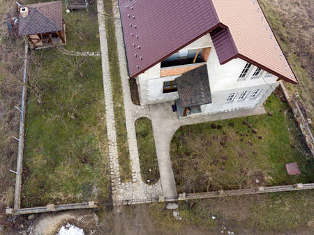 Aerial view of new residential house cottage with shingle roof. Stock Photo - 124556698