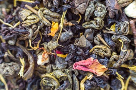 Close-up of dry tea herbal petals abstract dark colorful background. Healthy lifestyle, natural antioxidant drink, aromatherapy concept. Imagens