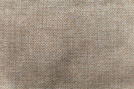 Gray beige linen canvas surface background. Sackcloth design, ecological cotton textile, fashionable woven flex burlap. Foto de archivo - 124554752