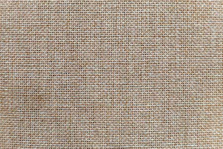 Gray beige linen canvas surface background. Sackcloth design, ecological cotton textile, fashionable woven flex burlap. Stock Photo