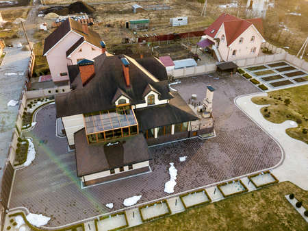 Aerial top view of new residential house cottage with shingle roof on fenced big yard on sunny day. Stock Photo - 124550734