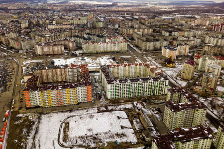 Top view of winter city landscape with tall buildings. Drone aerial photography.