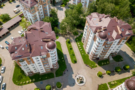 Top view of apartment or office tall buildings, parked cars, urban city landscape. Drone aerial photography. Stok Fotoğraf