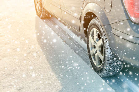 Close-up of car wheels rubber tires in deep winter snow. Transportation and safety concept. Stock fotó - 128342856