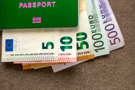 Travel passport and money, Euro banknotes bills on copy space background, top view. Traveling and  finance problems concept.