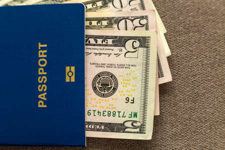Travel passport and money, American dollars banknotes bills on copy space background, top view. Traveling and  finance problems concept. Stockfoto