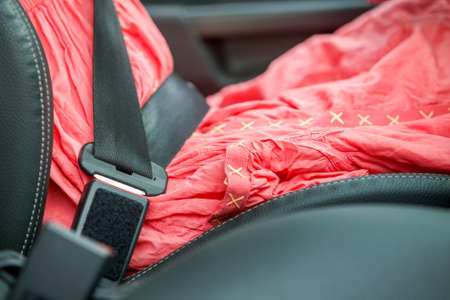 Young woman inside car buckled up with protective seat belt. Safety and precaution concept.