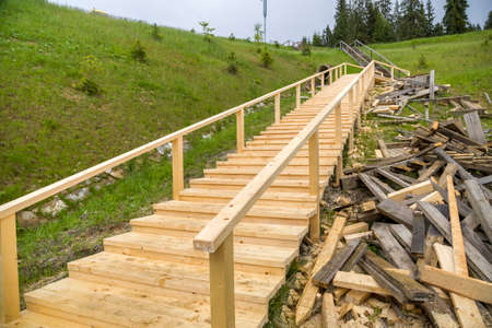 New wooden stairs outdoors. Carpenters work.