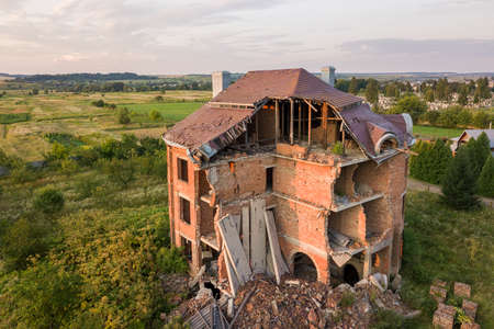 Old ruined building after earthquake. A collapsed brick house .