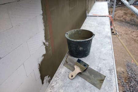 Tools and material foe covering walls with protective adhesive before finish paint.