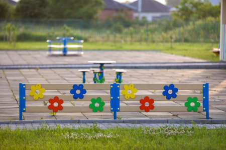 Multicolored wooden or plastic low decorative fence outdoors on sunny summer day. Foto de archivo - 131286036