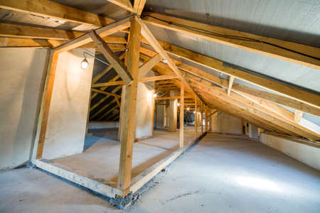 Attic of a building with wooden beams of a roof structure. Banco de Imagens