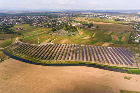 Aerial view of solar power plant. Electric panels for producing clean ecologic energy.