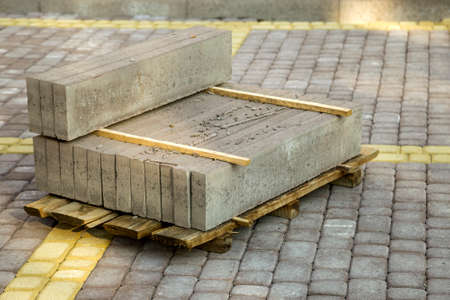 Installation of stone paving slabs in a yard. Stock Photo