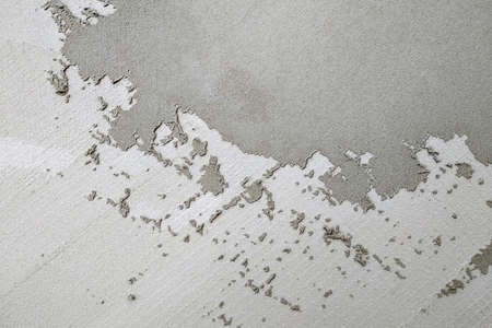Abstract grey textured backgroung. Wall covered with cement mortar. Stock Photo