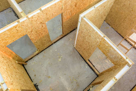 Construction of new and modern modular house. Walls made from composite wooden sip panels with foam board insulation inside. Building new frame of energy efficient home concept.