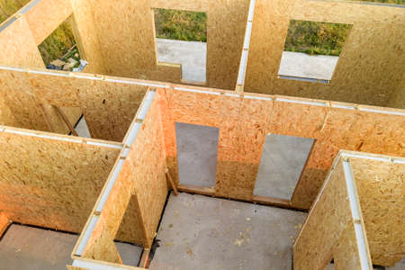 Construction of new and modern modular house. Walls made from composite wooden sip panels with styrofoam insulation inside. Building new frame of energy efficient home concept. Stock Photo