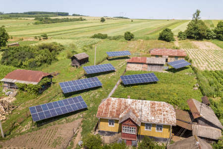 Aerial view of solar panels in rural country area.