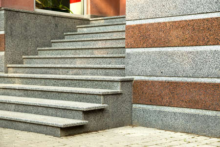 Detail of a house facade. New granite stairs.
