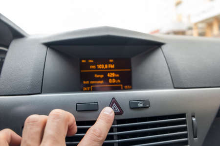 Red triangle emergency button in a car interior.