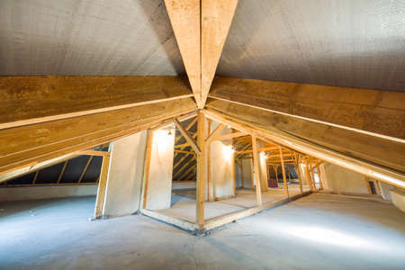 Attic of a building with wooden beams of a roof structure. Stok Fotoğraf