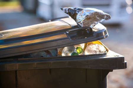 Closeup of trash can container full of garbage. Stock Photo - 134715621