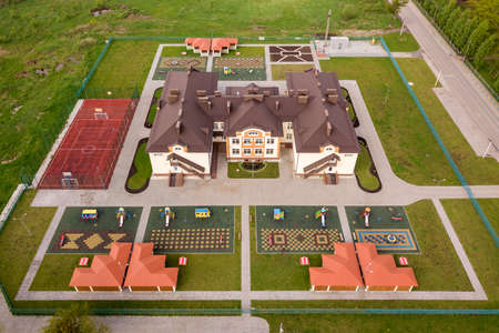 Aerial view of new prescool building in residential rural area. Archivio Fotografico - 134715966