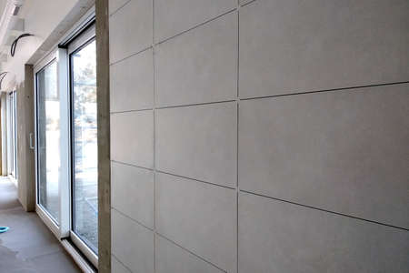 Wall ceramic tiles installation on mortar glue.