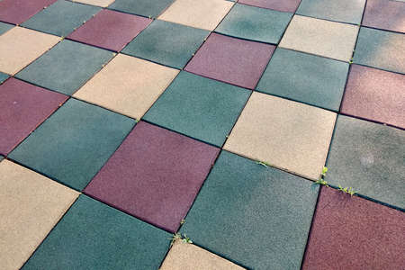 Close up of soft rubber tiles for covering at outdoor gym of stadium at preschool yard. Archivio Fotografico - 134716815
