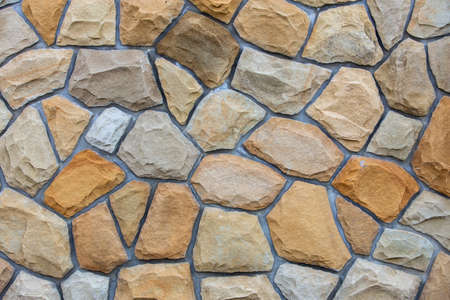 Abstrakte Wandoberfläche aus Sandsteinen zur Verwendung als Hintergrund.