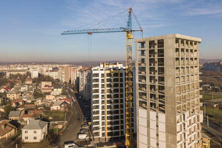 Aerial view of concrete frame of tall apartment building under construction in a city. Stock fotó