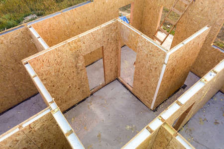 Construction of new and modern modular house. Walls made from composite wooden sip panels with styro foam insulation inside. Building new frame of energy efficient home concept. Stock Photo
