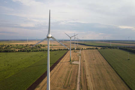 Aerial view of wind turbine generators in field producing clean ecological electricity. Stock Photo