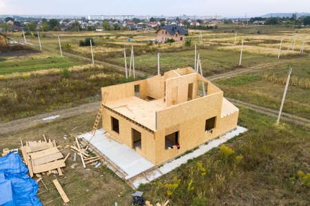 Construction of new and modern modular house. Walls made from composite wooden sip panels with plastic insulation inside. Building new frame of energy efficient home concept.