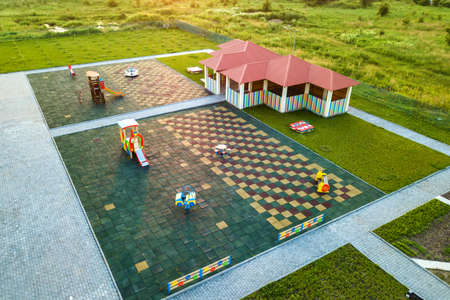 Aerial view of new alcove in kindergarten play yard with red tiled roof for outdoor children activities. 스톡 콘텐츠