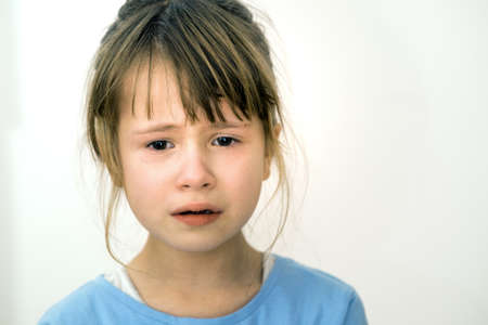 Closeup portrait of sad crying child girl.