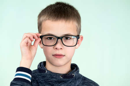 Close up portrait of a child school boy wearing glasses. Stock Photo