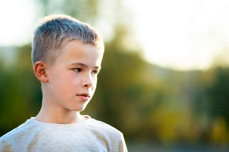 Portrait of a child boy outdoors on a warm sunny summer day.