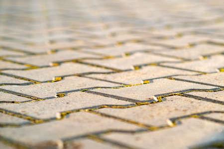 Closeup detail of gray concrete yard pavement slabs.