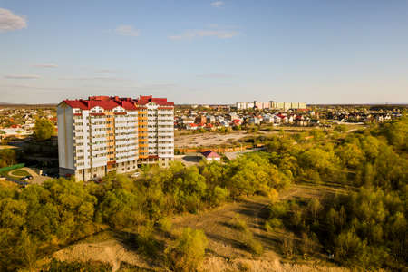Aerial view of high residential apartment building in green rural area in Ivano-Frankivsk city, Ukraine 스톡 콘텐츠