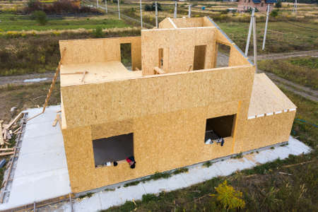 Construction of new and modern modular house. Walls made from composite wooden sip panels with styro-foam insulation inside. Building new frame of energy efficient home concept.