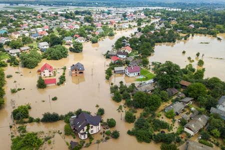Aerial view of flooded houses with dirty water of Dnister river in Halych town, western Ukraine. Banque d'images