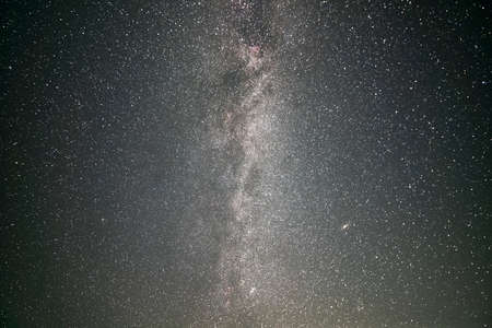 Black night stars covered sky with bright Milky Way galaxy. Stock Photo