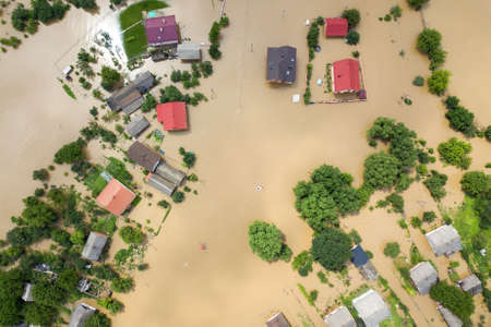 Aerial view of flooded houses with dirty water of Dnister river in Halych town, western Ukraine. Banco de Imagens