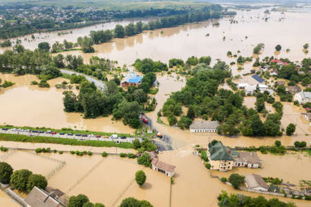 Aerial view of flooded houses with dirty water of Dnister river in Halych town, western Ukraine. Stockfoto